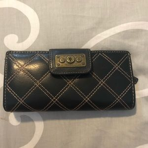 Black leather with tan stitching fossil wallet